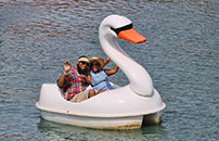 Couple relaxing on the swan boat as they float around lake Broadway