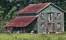 old barns and houses along sideroads